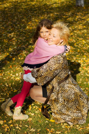 Mother and daughter embracing in the park. photo