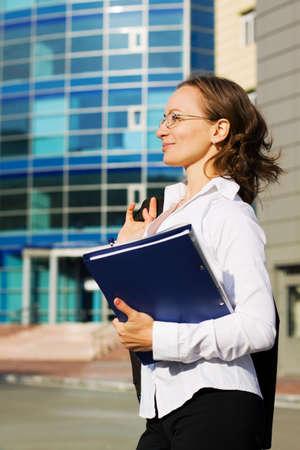 Happy businesswoman holding a folder. photo