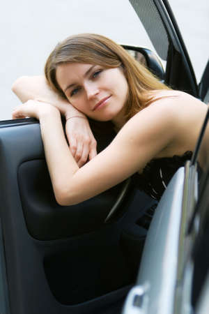 Tired young woman relaxing in the car. photo