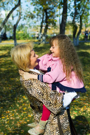 Happy mother and daughter embracing in the park. Stock Photo - 5813493