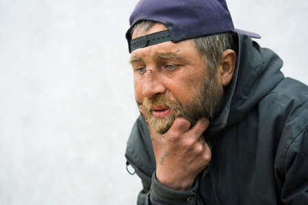 old beggar: Homeless man.
