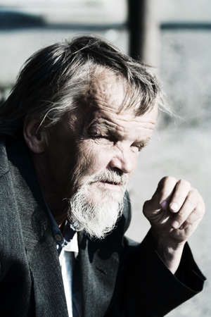 old beggar: Sad old man. Stock Photo
