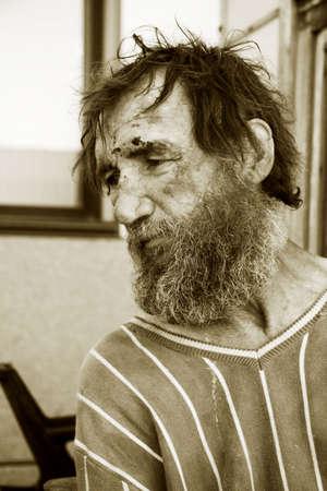 Despair of the poor homeless beggar. photo