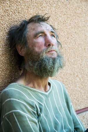 old beggar: Despair of the poor homeless beggar.