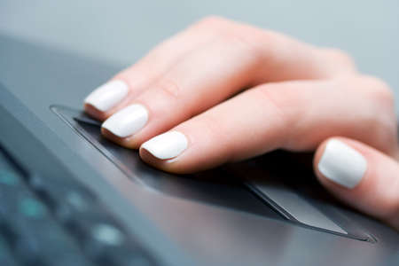 Female hand working on the laptop. Stock Photo - 5895175