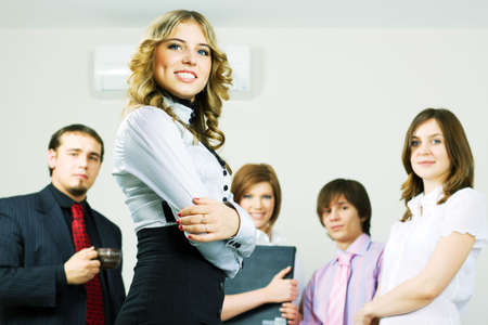 Happy young businesswoman with colleagues. photo