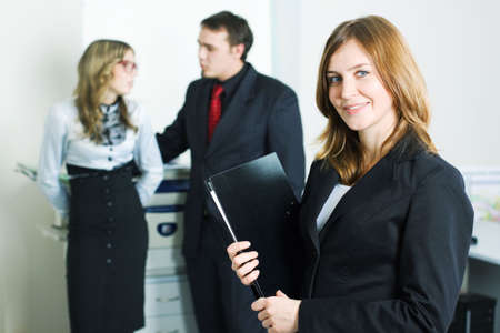 Happy young businesswoman with colleagues. Stock Photo - 5907000