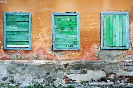 Three boarded up windows. Stock Photo - 5927224