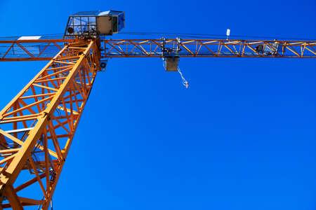 Construction crane against a blue sky. photo