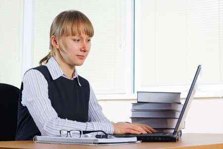 Young businesswoman working on the laptop at office. Stock Photo - 6090484