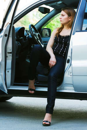 Tired young woman resting in the car. photo