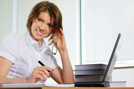 Young businesswoman working on laptop. photo