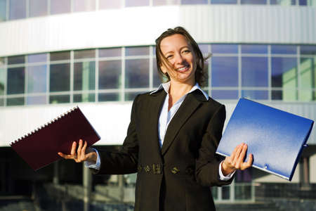 Happy businesswoman holding a folders. photo