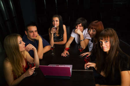Young friends meeting in a bar. photo