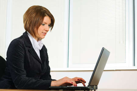 Young businesswoman working on the laptop at office. Stock Photo - 6172350