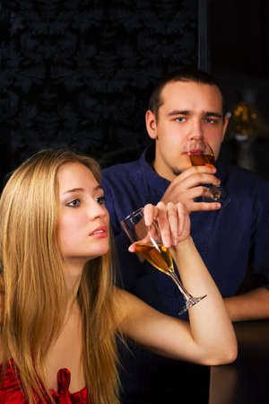 Young couple relaxing in a bar. Stock Photo - 6172349