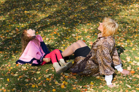 Mother and daughter relaxing on the grass. photo