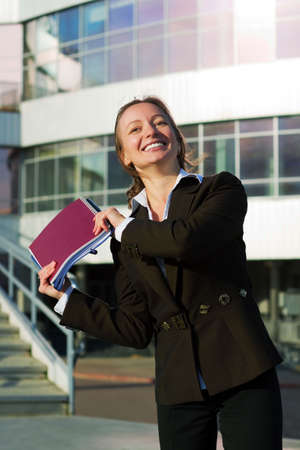 Happy businesswoman with a notebooks. photo