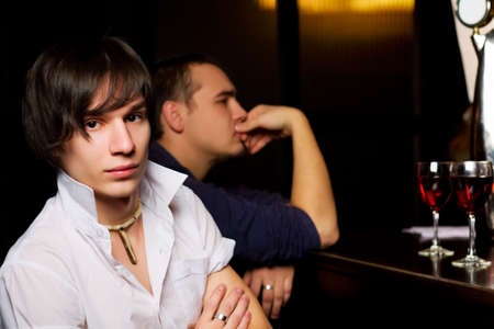 Young men relaxing in a bar. photo