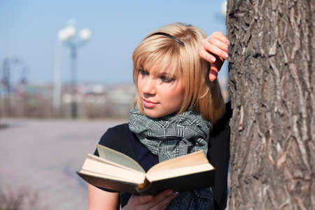Young woman reading a book. photo