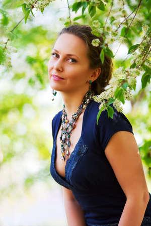 Beautiful woman among blossom. photo