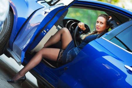 Beautiful woman sitting in a sports car. photo