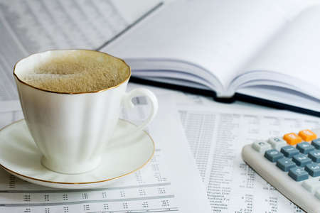 Coffee and financial accounting. photo