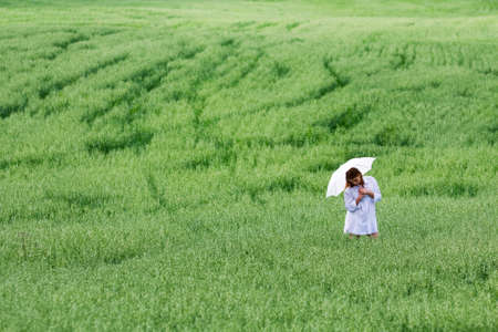 Young woman walking in a field. photo