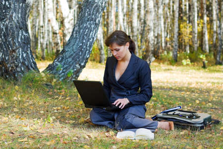 Young businesswoman working in the forest. Stock Photo - 7319172