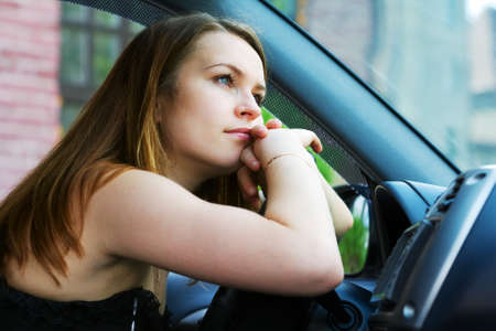 female driver: Tired woman resting in the car.