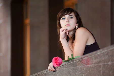 Young woman with red rose. Stock Photo - 7364912