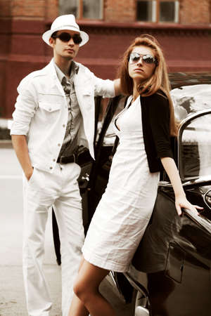 elegant couple: Young couple with a retro car. Stock Photo