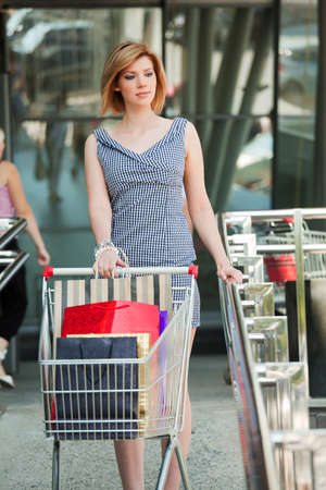 Young woman with shopping cart. photo