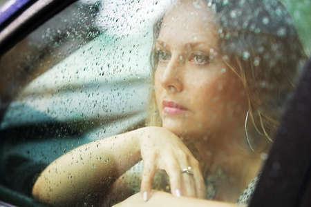 Sad woman and rain. photo