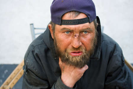poor people: Homeless man in depression. Stock Photo
