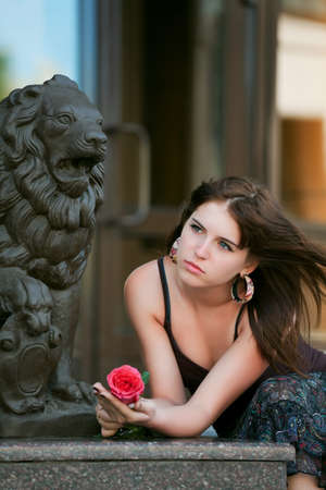 Sad young woman with red rose. Stock Photo - 7907723