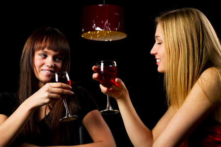 Two young women in a bar. photo