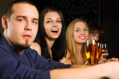 Young people relaxing in a night bar. photo