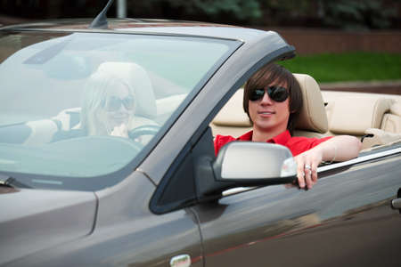 Happy young couple in the convertible car. Stock Photo - 7907741