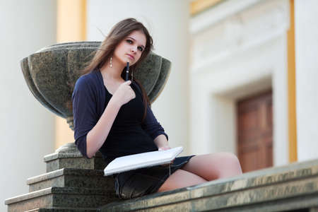 Young female student before exam. photo
