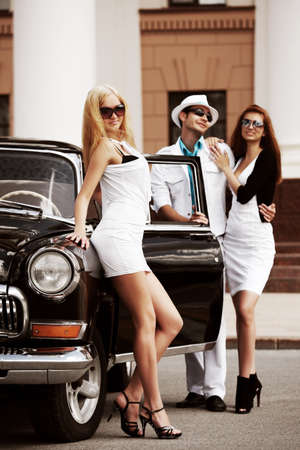 Young people with a retro car. photo