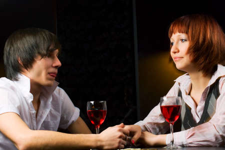 Young couple drinking red wine in a bar. Stock Photo - 8139089