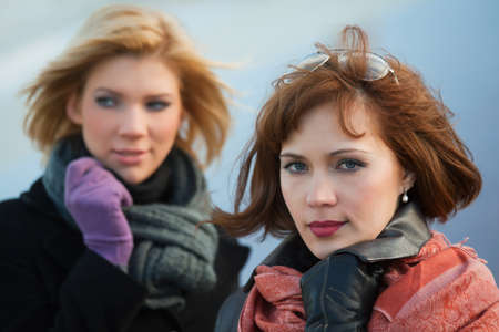 Two young women on the city street. photo