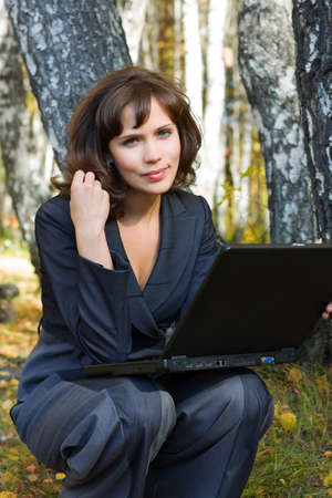 Young businesswoman working on the laptop. photo