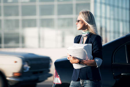 Businesswoman with financial reports.