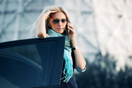 Businesswoman on the phone against industrial background.