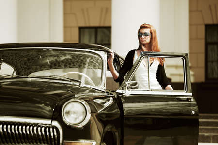 urban fashion: Young woman with a retro car.