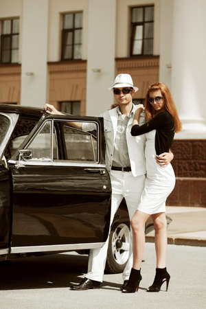 Young couple with a retro car. Stock Photo - 8753160