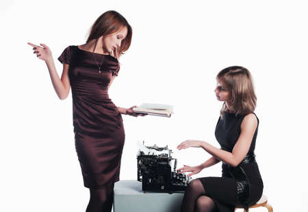 Two young retro secretaries with a typewriter photo