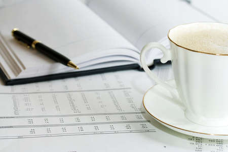 Cup of coffee and accounting photo